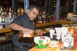 "Vandome Bartender / Main Room / Preparing Signature Drink "" Scorpion Bowl """